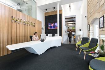 Organic multi curved reception counter seamless thermoformed in Glacier White Corian®