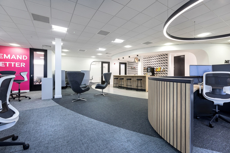 Curved Slatted Reception Desk and breakout area furniture