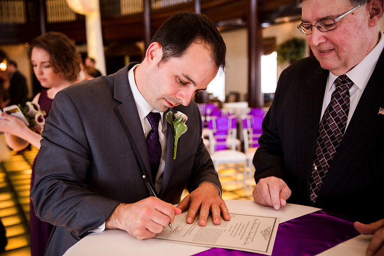Best Man Signs the Marriage License