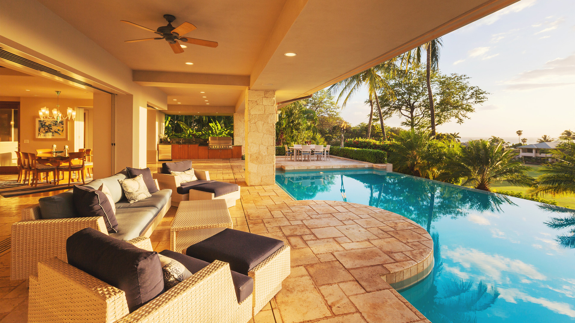luxury-home-with-pool-at-sunset-56923520