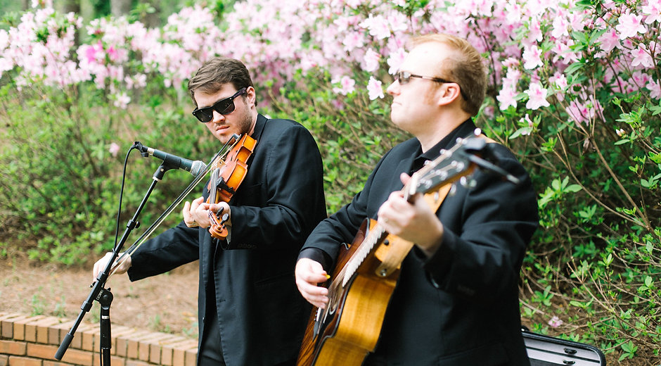 Acoustic Guitarist and Violinist performing for the ceremony