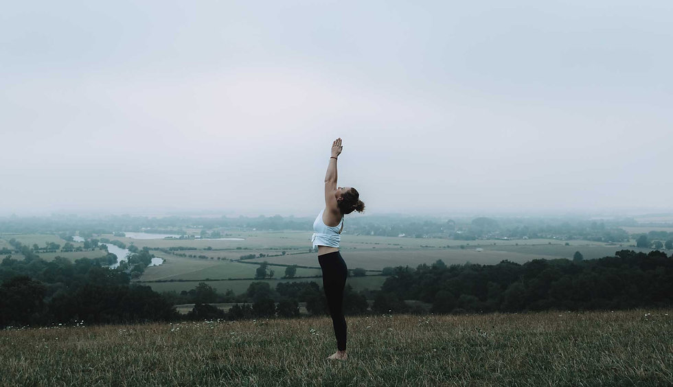 One to One page banner - Helen in yoga pose reaching up