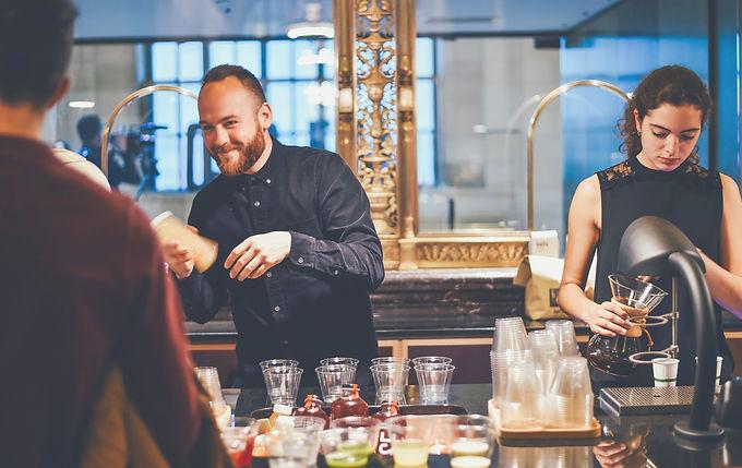 Bartenders serving cocktails