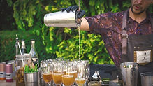 Barman Pouring Cocktails at an Event