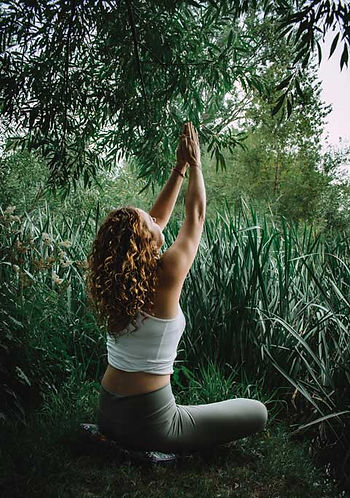 Helen practicing yoga in nature