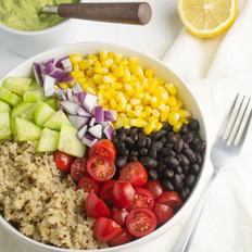 quinoa with veggies and creamy avocado sauce