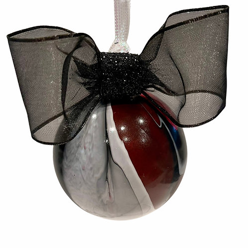Front View of Modern Black, Red, and White Painted Glass Ball Ornament