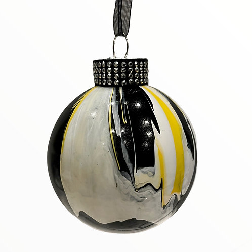 Front View of Modern Black, Yellow, White Painted Glass Ball Ornament