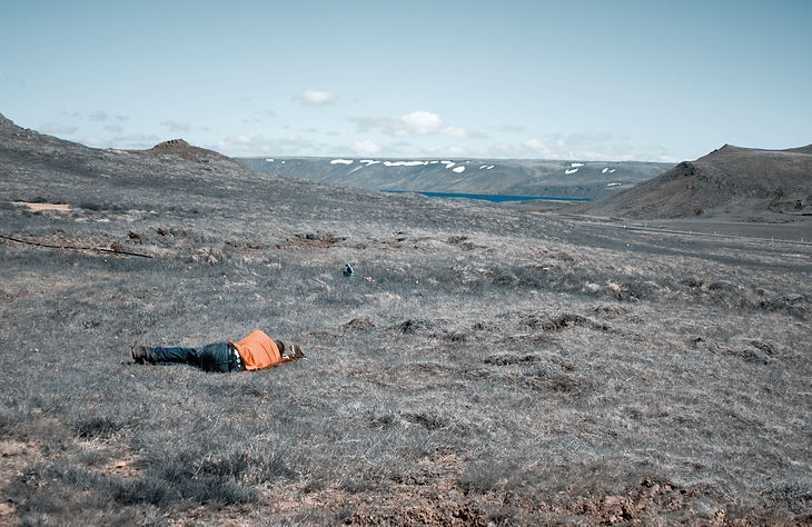 Man laying down in Icelandic landscape