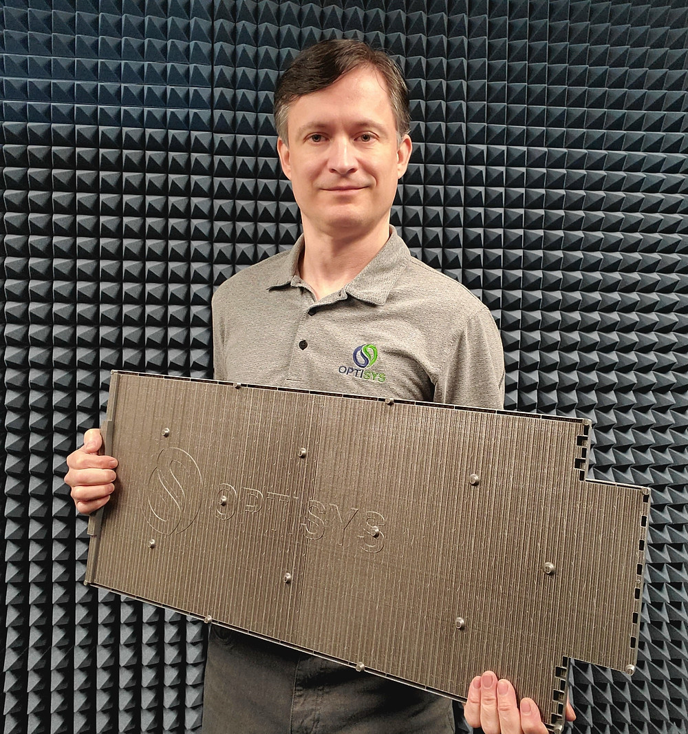 Janos Opra, Optisys CEO, holds the worlds largest monolithic 3D printed metal antenna
