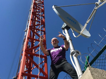 Axess Networks provides cellular phone coverage via satellite for WOM in Colombia