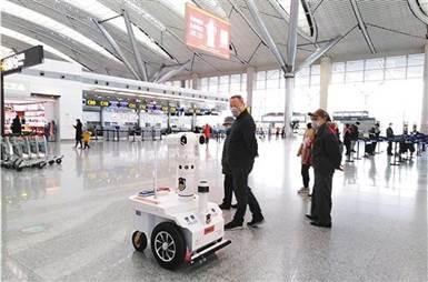 Temperature-scanning 5G patrol robot checks passenger temperatures at Guiyang Airport, China