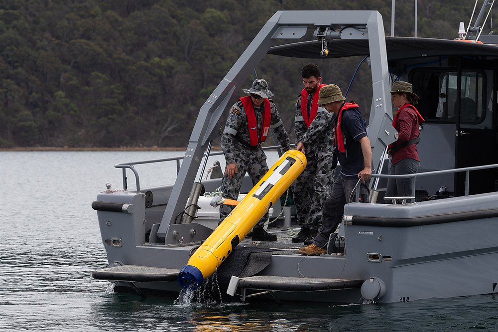 Australian Mine Warfare Team 16, MCDGRP and DSTG staff operating the Bluefin 9 autonomous underwater vehicle (AUV) from a Mine Countermeasure Support Boat (MCMSB) during a Project Sea 1778 equipment application course at Pittwater, NSW. Image from Commonwealth of Australia, 2020.