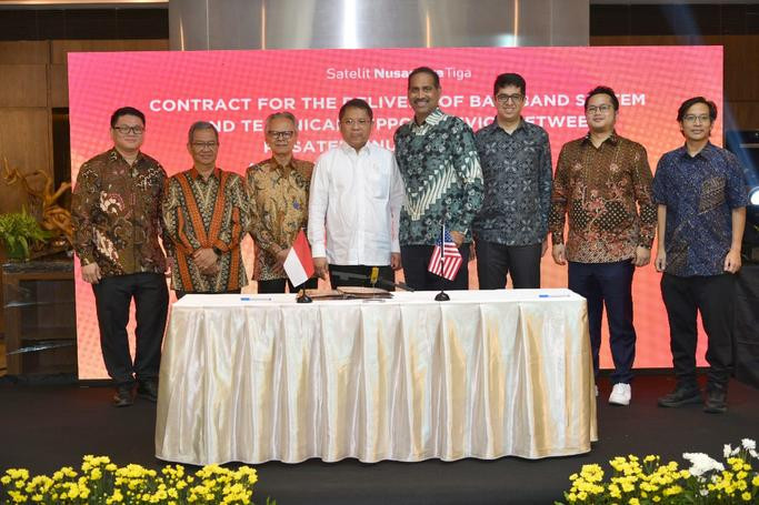 left to right, at a signing ceremony in Jakarta, Indonesia: Mr. Timotius Sulaeman, PT. Dian Semesta Sentosa; Mr. Adi Rahman Adiwoso, PT. PSN; Mr. Erry Riana Hardjapamekas, PT. PSN; Mr. Rudiantara, Minister of Communication & Information Technology; Mr. Ramesh Ramaswamy, Hughes; Mr. Vaibhav Magow, Hughes; Mr. Arif Medianto, PT. Pintar Nusantara Sejahtera; and Mr. Adi Widjonarko, PT. Nusantara Satelit Sejahtera.