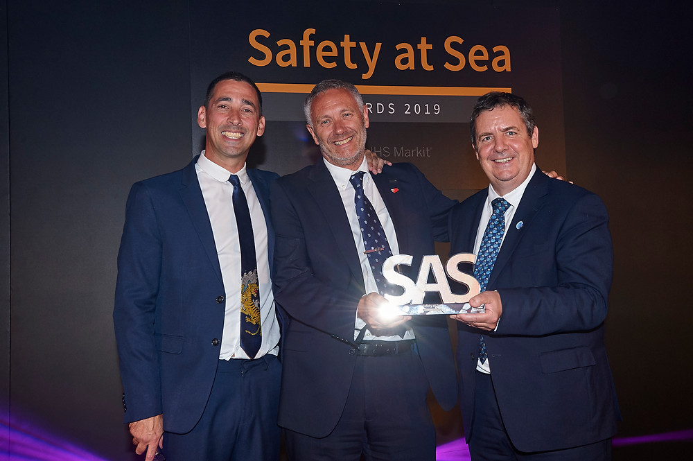 Peter Broadhurst, Senior VP Safety and Security, receiving the award from broadcaster Colin Murray (left) and Guy Platten, Secretary General, International Chamber of Shipping.