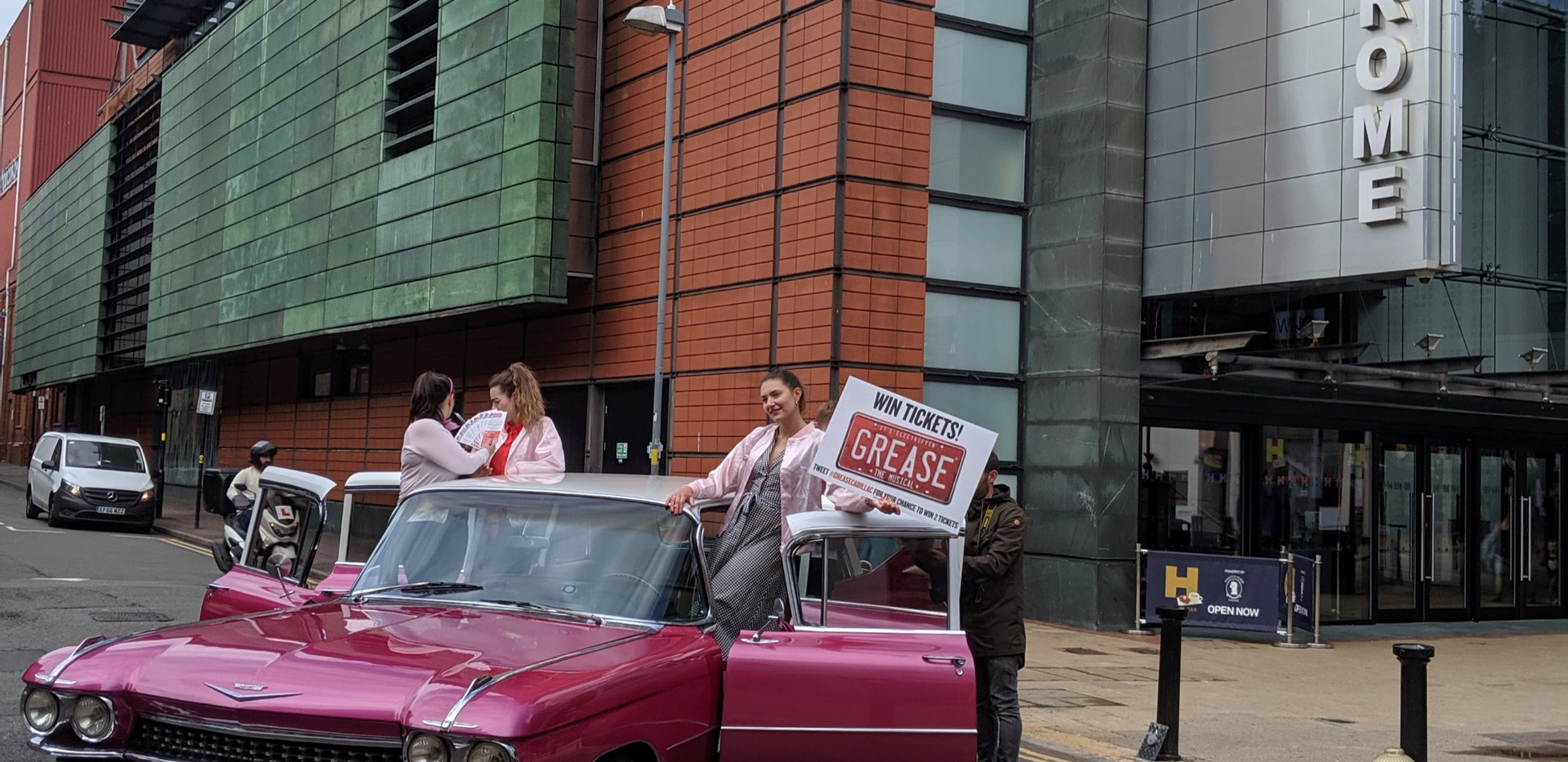 Advertising the new musical of grease.