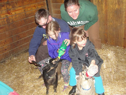 Family with baby goats.jpg