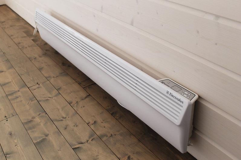Отопление электричеством современного загорордного дома