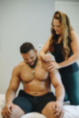 Michelle Rozzen massaging Aaron Doald