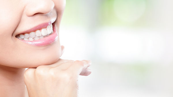 Beautiful young woman teeth close up wit