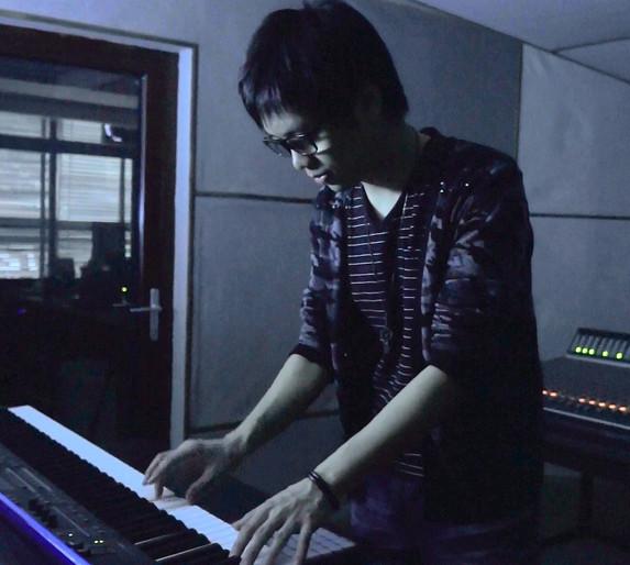 Dominic Au recording in studio.