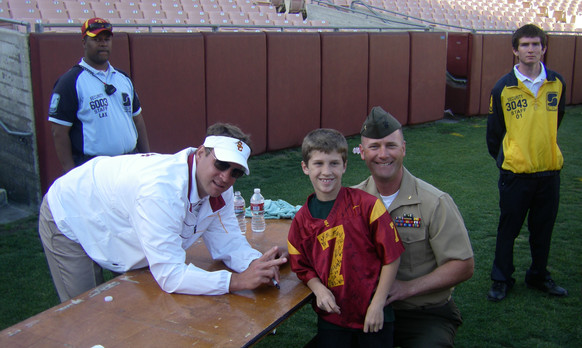 Coach Lane Kiffin with a troop and his son.