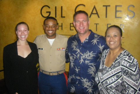 Military family and friends enjoying a night at the theater.