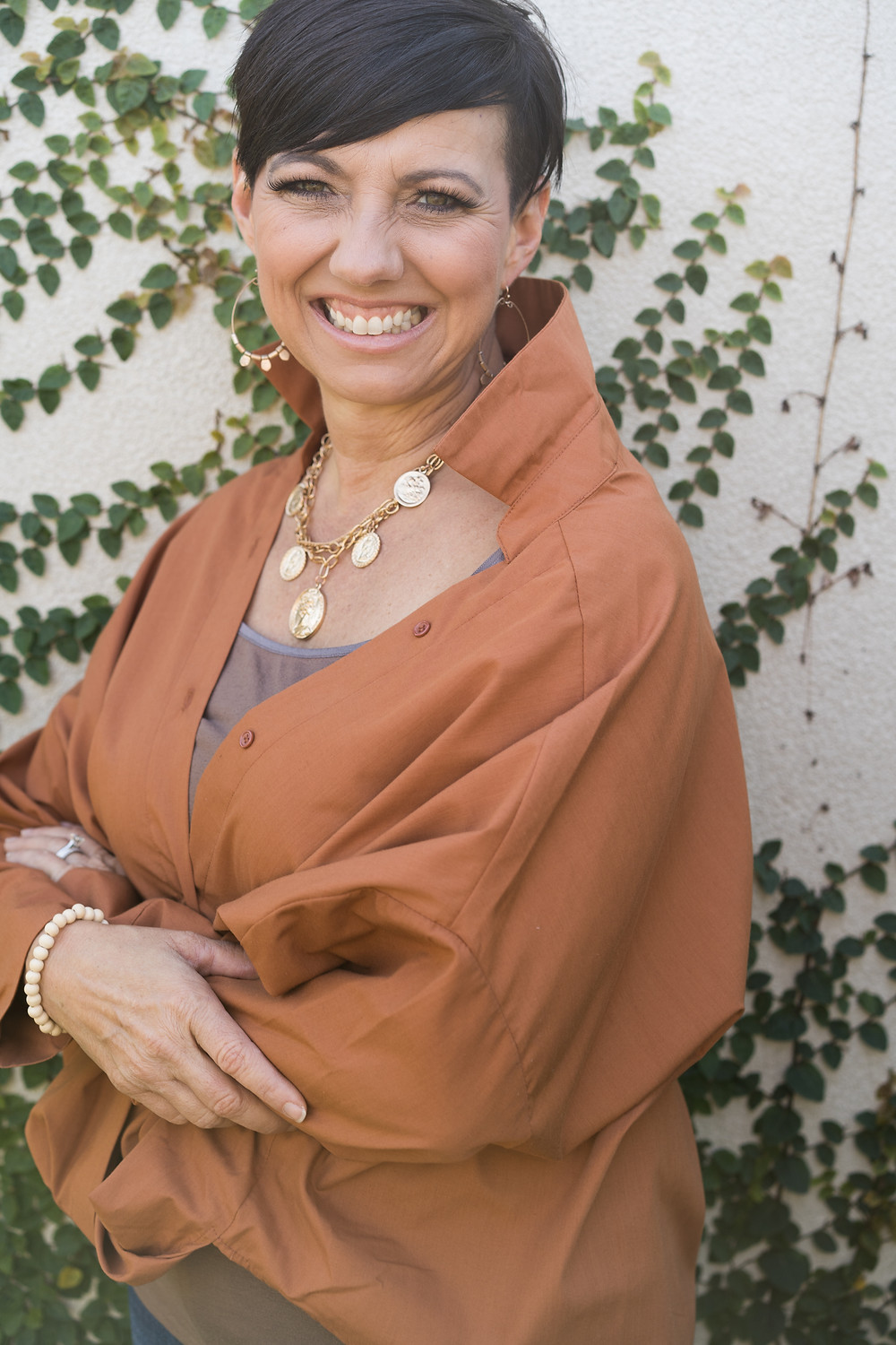 Freedom Life Coach, Speaker, Author, and the founder of The Brave Gathering event for women.