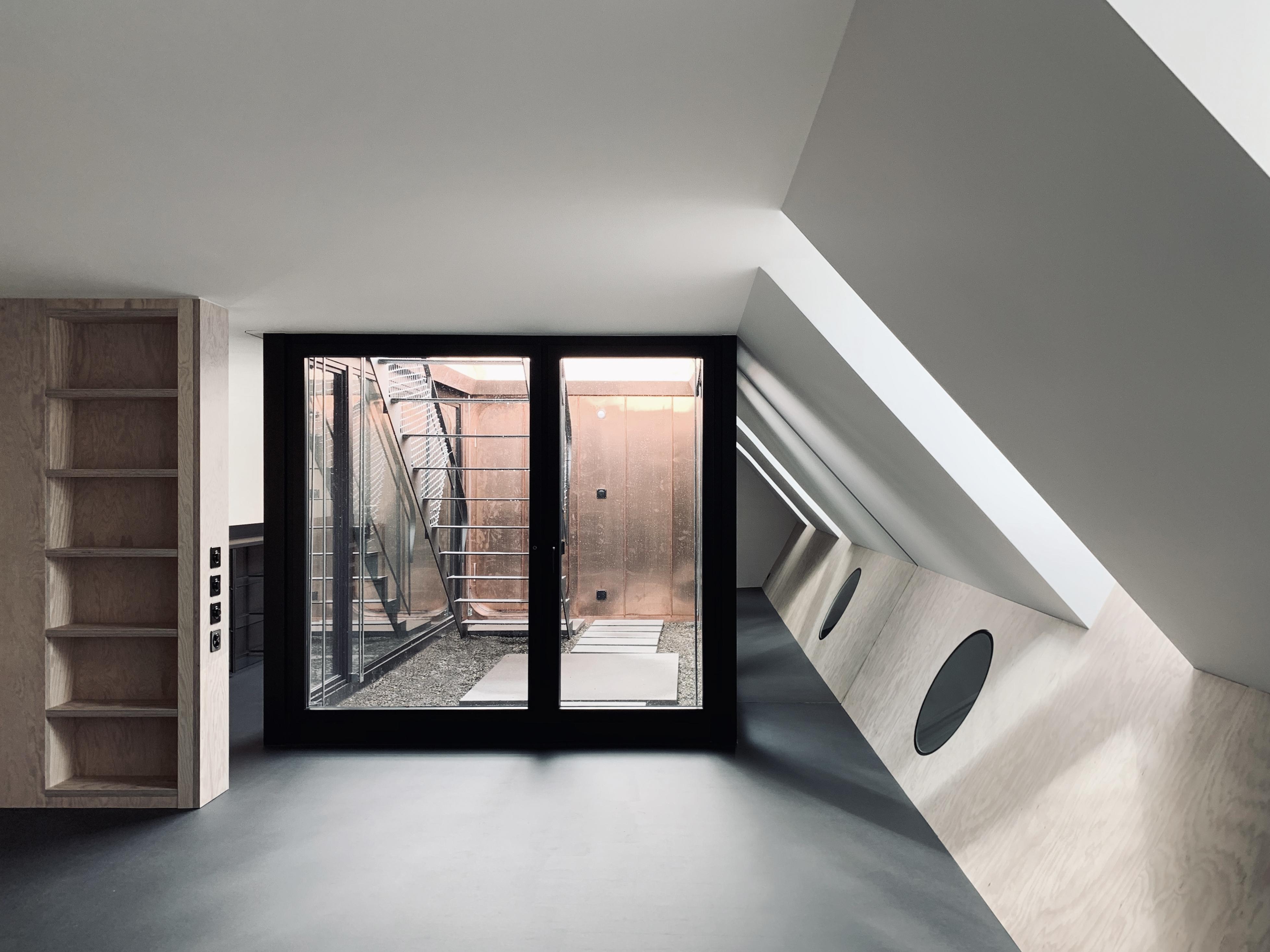Umbau Wohnhaus Zürich: Schlafzimmer mit Atrium Dachwohnung