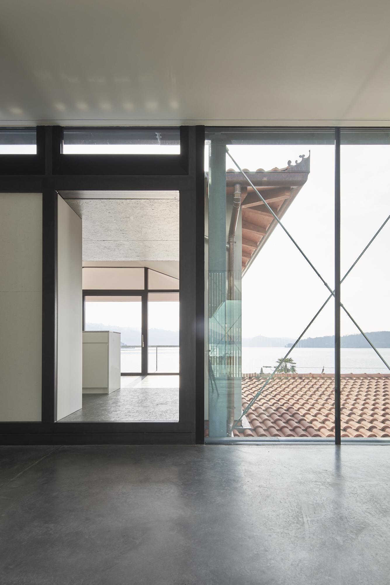 Umbau Villa am See Pella: Übergang An- und Umbau
