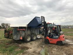 dumping old crop in spreader