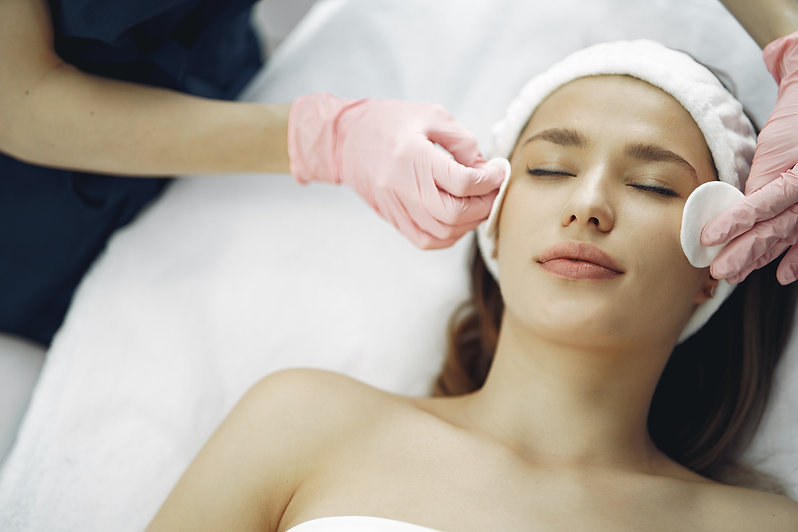 woman-getting-a-facial-treatment-3985329