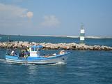 fishing boat leaving fuzeta harbour.jpg