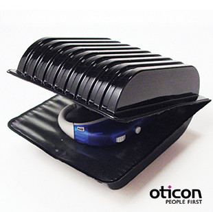 A two piece packaging system that protects the hearing aid for storage and transportation. Client: Oticon