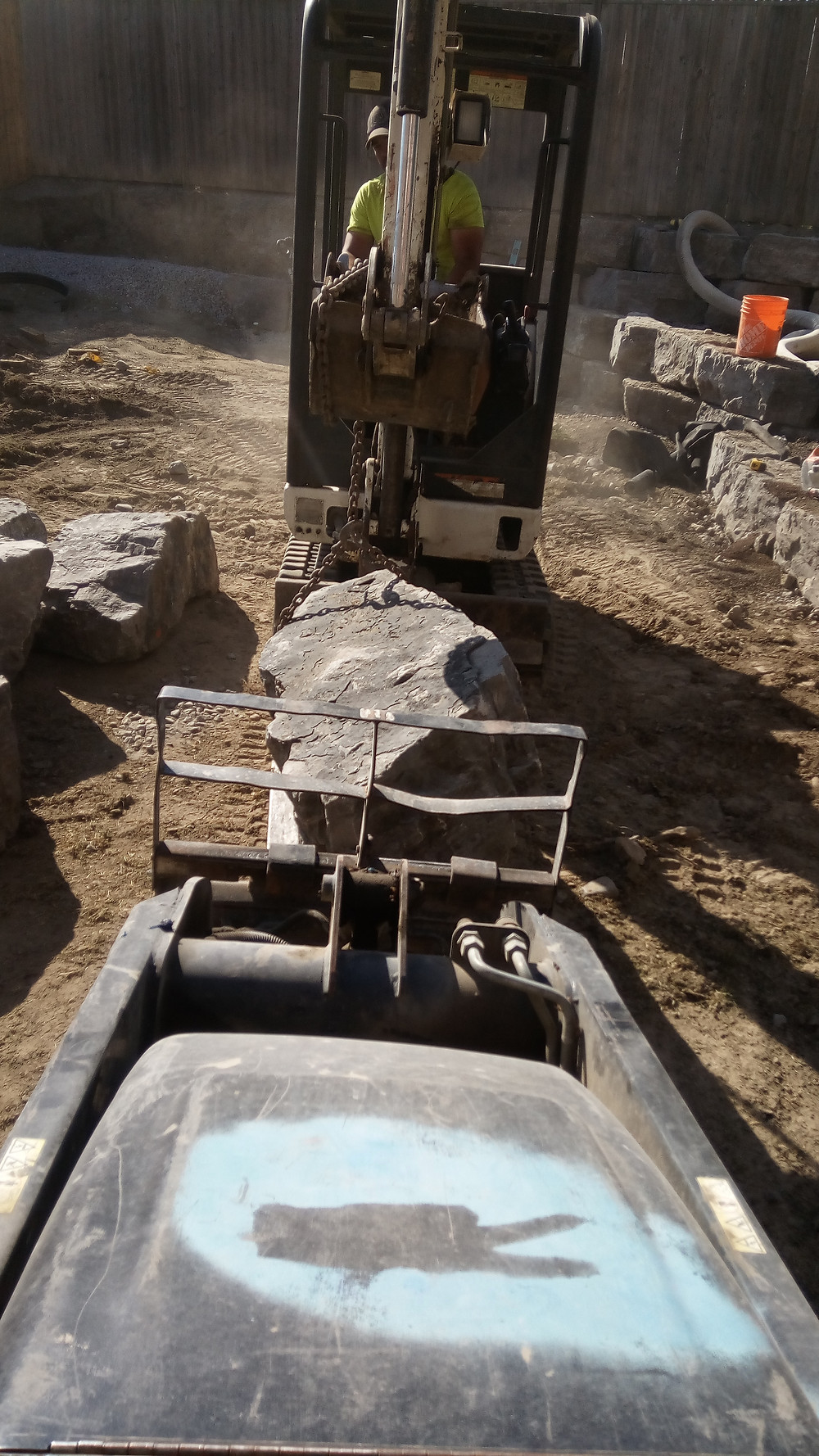 Installation of natural stone retaining wall in oshawa by landscape contractors