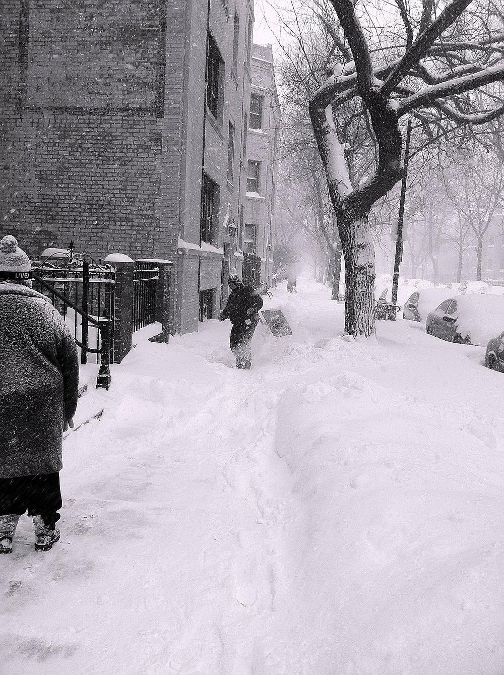 Snow removal of city sidewalk in the Durham Region