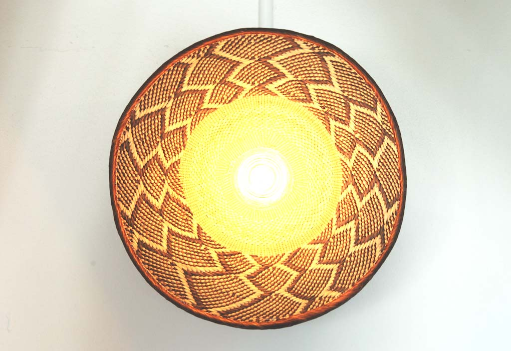 zimbabwe flat basket lights Dreamers & Drifters retail boutique retail fit interior design byron bay