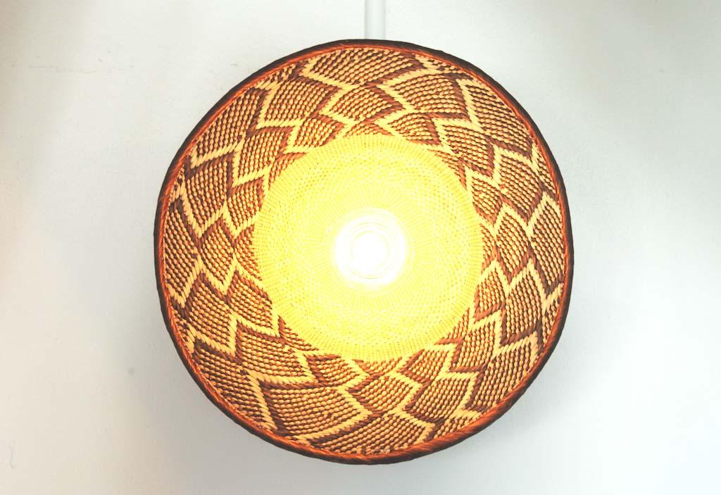 zimbabwe flat basket lights Dreamers & Drifters retail boutique retail fit interior design byron bay