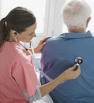 Home Nurse Examining Patient