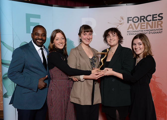 Co-Founder Chloe Pronovost-Morgan, Co-Presidents Anais Pronovost-Morgan and Sophia Heath, and VP External Maddie Coombs accepting the Forces AVENIR prize