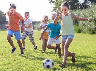 active kids having fun and kicking footb