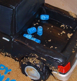 Carved 3-D truck with beer