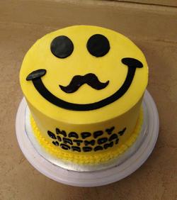 Birthday smiley face mustache cake