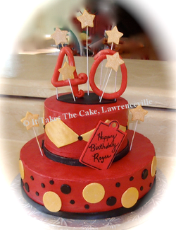 Red black gold birthday cake.png
