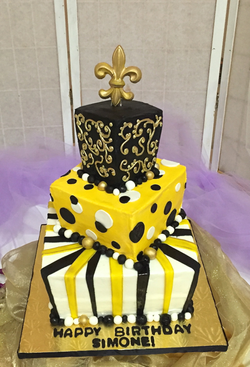 Birthday cake 3 teir black and yellow with flur de le.png