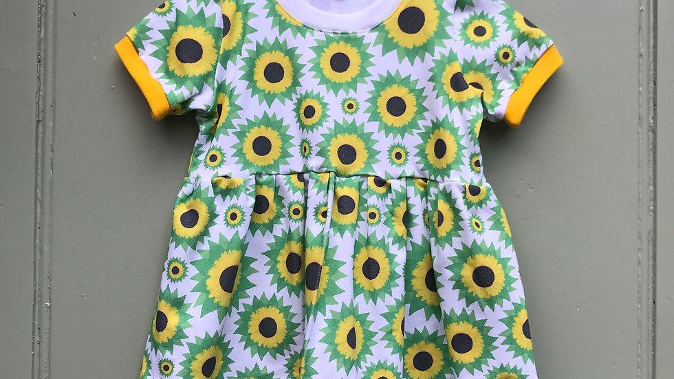Dress in Sunflowers .