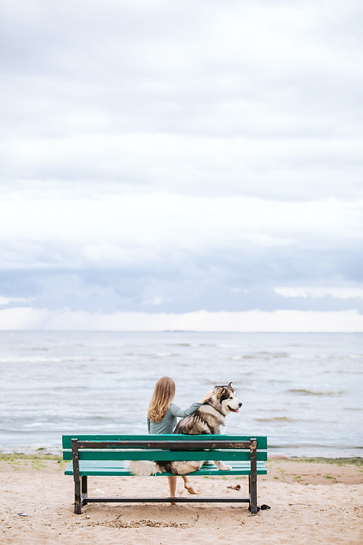 woman and dog on beach.jpg