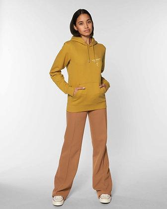 Woman in ochre organic hoodie
