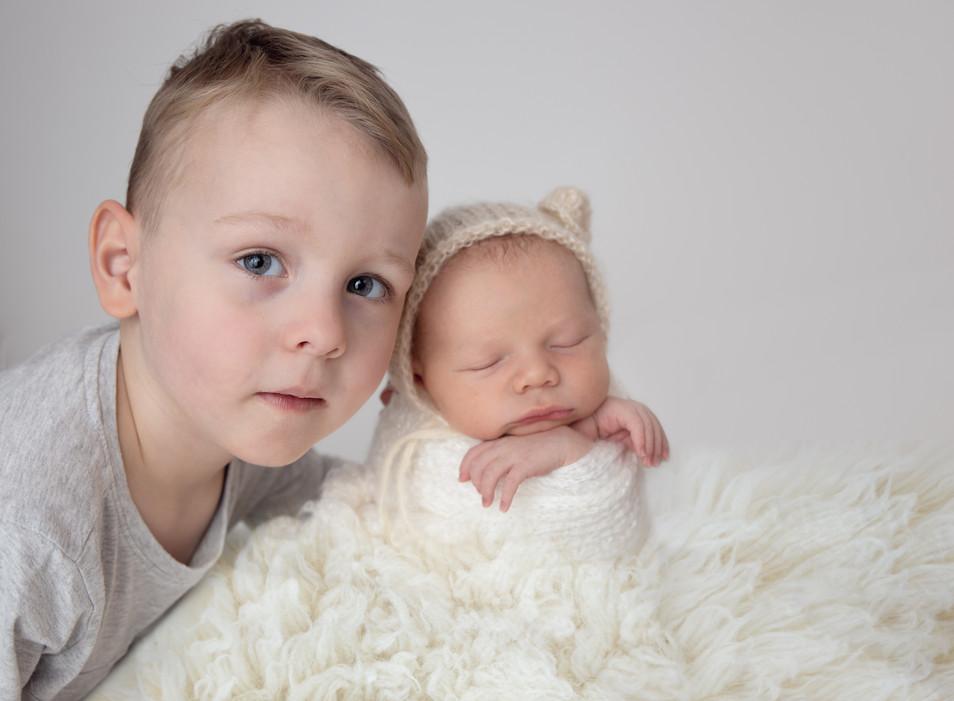 Newborn sibling images.jpg