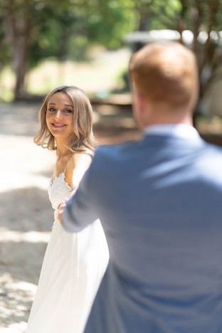 Bride looking at husband wedding photography